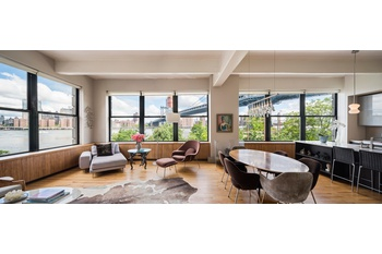 STUNNING massive corner loft with unparalleled views of the East River, Bridges and Skyline!
